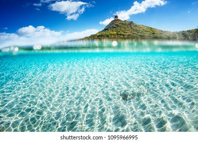 "Half underwater of turquoise sea of Sardinia in the bay of "" Porto Giunco"" - Villasimus"