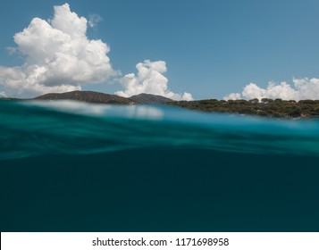 Half underwater view of beautiful place in - Sardinia - italy.