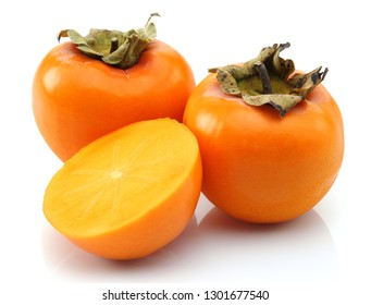 Half and whole Persimmon fruits isolated on white background