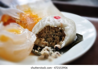 Half-cut of chinese mochi, vegetarian dessert, filled with black bean. A dessert dish from Po Lin monastery, Ngong Ping, Hong Kong