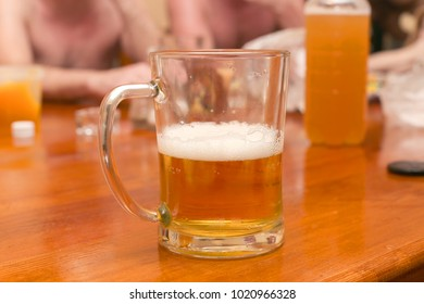 half-empty glass of beer