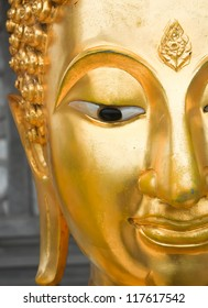 half-face of buddha head image with symbol of buddhism on forehead