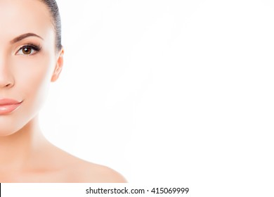 Half-face portrait of beautiful sensitive woman on white background