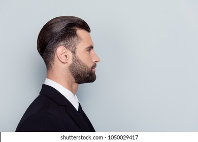 Half-faced close up portrait of serious confident strict concentrated handsome attractive thinking pensive minded with stylish trendy hairdo haircut chief isolated on gray background copy-sapce