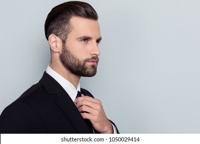 Half-faced portrait of stylish trendy handsome stunning attractive serious concentrated smart clever intelligent with modern haircut hairdo isolated on gray background copy-space