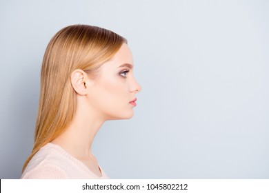 Half-faced profile side view close up portrait of serious confident focused concentrated thinking pondering pretty cute lovely manager wearing beige blouse isolated on gray background copyspace