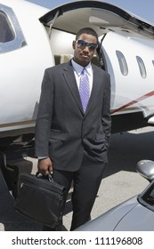 Half-length of businessman getting out from a jet
