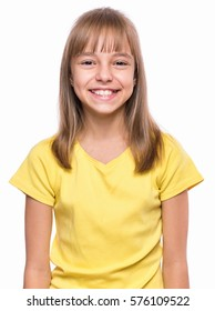 Half-length emotional portrait of caucasian girl wearing yellow t-shirt. Happy schoolgirl looking at camera and laughing. Funny cute smiling child, isolated on white background.