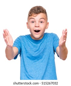 Half-length emotional portrait of caucasian teen boy wearing blue t-shirt. Surprised teenager looking at camera. Handsome happy child, isolated on white background.