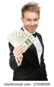 Half-length portrait of businessman handing cash, isolated on white. Concept of wealth and income
