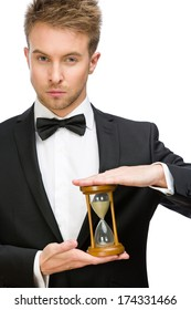 Half-length portrait of businessman keeping hourglass, isolated on white