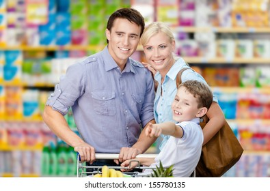 Half-length portrait of family in the shop. Concept of consumerism and family relations