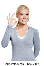 Half-length portrait of female okay gesturing, isolated on white