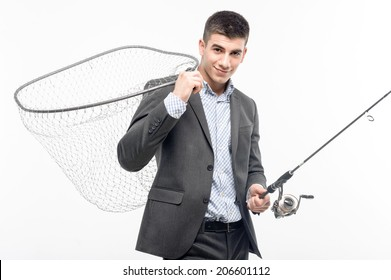 Half-length portrait of handsome smiling young businessman standing with net on his shoulder and spinner in the hand. He is ready for the fishing. Isolated on white background