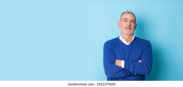 half-length portrait of man in sweater and shirt with beard and gray hair