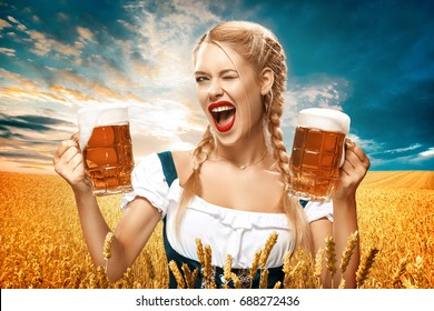 Half-length portrait of young sexy blonde with big breast wearing black dirndl with white blouse holding the beer mug Isolated on dark background