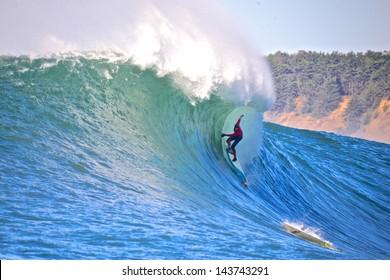 HALFMOON BAY, CALIFORNIA - JAN 22: Pro surfer Peter Mel surfs a barrel at the Mavericks Invitational 2013 at Mavericks in Halfmoon Bay, California.