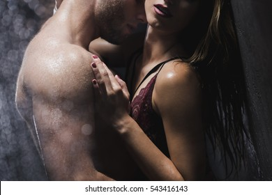Half-naked man and woman in intimate situation are  touching each other in the shower