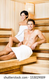 Half-naked man and woman relaxing in sauna. Concept of self-care, health and relaxation