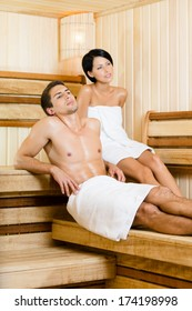 Half-naked man and young woman relaxing in sauna. Concept of self-care, health and relaxation