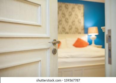 Half Open Door Of A Bedroom