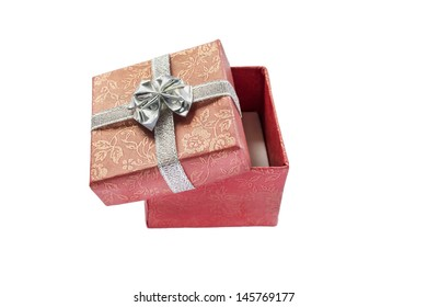 Half-opened red silk box isolated over white