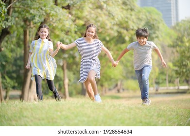 A half-Thai-Indian boy and a half-Thai-European girl friend races in a park while learning outside of school