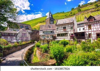 Half-timbered historical houses and vineyard hills in Bacharach, Germany, a romantic small town in Rhine river valley