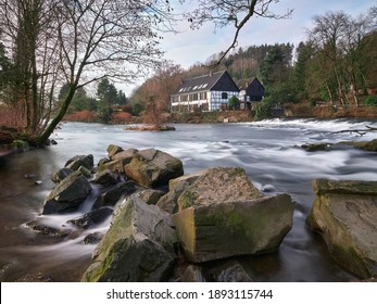 Half-timbered houses on the river bank. View on the Wipperkotten on the Wupper river, one of the landmarks of the Klingestadt Solingen in the Bergisches Land. Landscape photography
