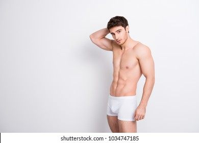 Half-turned portrait of handsome sportive attractive flirty coquettish confident muscular with ideal perfect athletic body guy fixing combing hair to the back isolated on white background copyspace