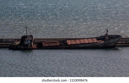 Halfway sunken ship rusting