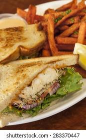 halibut sandwich with sweet potato fries