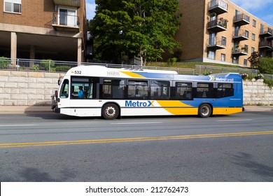 HALIFAX, CANADA  - 22ND AUGUST 2014: A public bus along a rural road in Halifax during the day