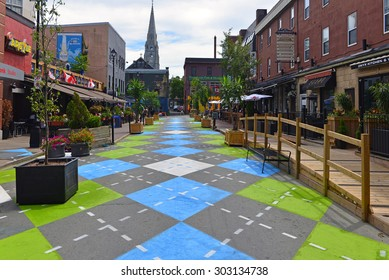 HALIFAX, CANADA AUG 3, 2015:  Argyle Street in Halifax, Nova Scotia, famous for its trendy bars and restaurants, with a new Argyle paint job on the section that has been closed to traffic.