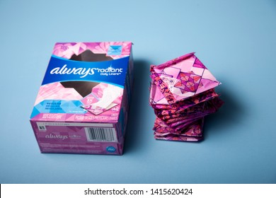 Halifax, Canada- May 31, 2019: A box of Always maxi pads beside small pads in purple packaging