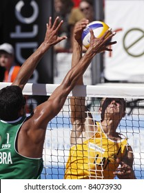HALIFAX, CANADA - SEPTEMBER 3: Vitor Felipe of Brazil and Abolins Armands of Latvia at the FIVB Beach Volleyball Swatch Junior World Championships on Sept. 3, 2011 in Halifax, Canada.