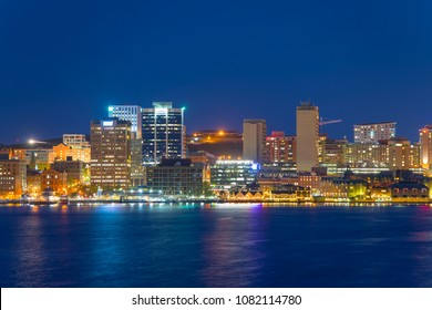 Halifax City skyline at night from Dartmouth waterfront, Nova Scotia, Canada.