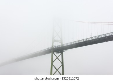 Halifax and Dartmouth's Macdonald bridge  on a foggy day.