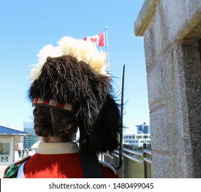 Halifax, Nova Scotia/ CA: May 13, 2019 - Dressed in the same uniforms that  regiments wore in mid-1800s, the 78th Highlanders guard Citadel's entrance. Hat is white vulture and black ostrich feathers.