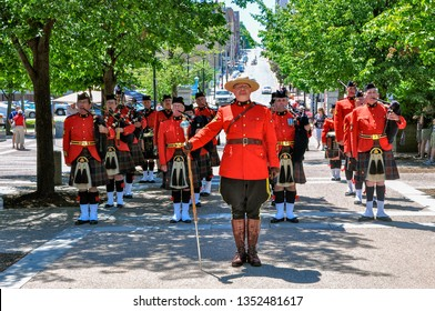 HALIFAX, NOVA SCOTIA, CANADA - JULY 20, 2009  The RCMP Halifax Pipe and Drum Band marches through town during Tall Ships 2009.
