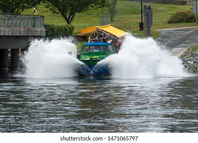 HALIFAX, NOVA SCOTIA, CANADA - JULY 25, 2019: Complete sequence of the Harbour Hopper tour vehicle turning from a bus to a boat seen in the Halifax harbour.