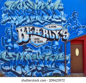 HALIFAX NOVA SCOTIA CANADA JUNE 3 Mural Blues downtown Halifax on june 03 2014 in Halifax canada. One of the best ways to deter vandals from applying graffiti is to strategically place murals in areas