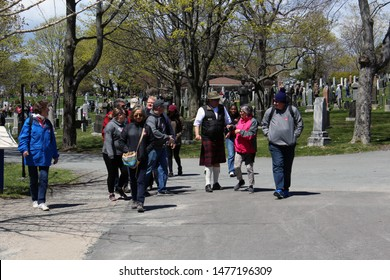 Halifax, Nova Scotia/ Canada: May 13, 2019 – Kilted guide leads visitors on tour of Fairview Lawn, known as Titanic Cemetery. Halifax played significant role in the recovery and burial of victims.