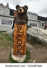 Halifax, Nova Nova Scotia, Canada, October 2, 2019: Peggy's Cove is the site of Peggys Point Lighthouse a wooden black bear welcome sign.