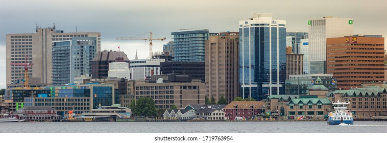 Halifax, Nova Scotia / Canada - Panorama shot of Halifax  Harbor front along with regional ferry. Halifax Skyline as seen from Dartmouth.