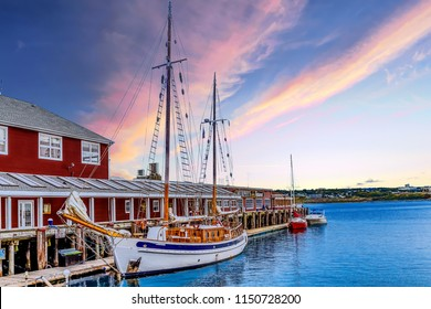 HALIFAX, NOVA SCOTIA - September 16, 2014: The Halifax Harbour Walk is a boardwalk open to the public 24 hours a day, which houses shops, restaurants and tourist excursion ships, such as this sailboat