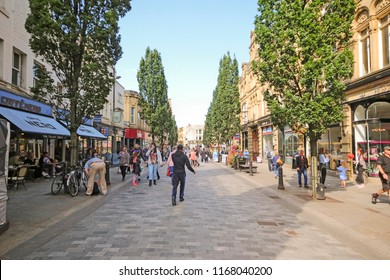 HALIFAX, UK - AUGUST 24, 2018: Pedestrianised shopping street in the centre of Halifax. Halifax is a Minster town and well known for the manufacture of wool from the 15th century