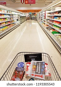 HALIFAX, UK - SEPTEMBER 25, 2018: View of an aisle at a Sainsbury's supermarket. This is the second largest chain of supermarkets in the United Kingdom, with a 16.9% share of the supermarket sector.