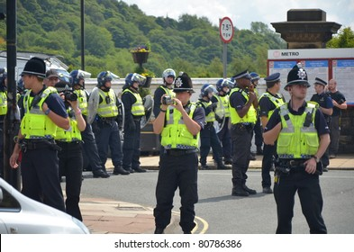 HALIFAX, WEST YORKSHIRE, ENGLAND-JUL 10: Riot Police face demonstrators of the EDL (English Defence League) organised rally on July 10, 2010 in Halifax, West Yorkshire