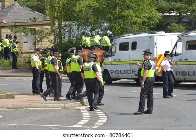 HALIFAX, WEST YORKSHIRE, ENGLAND-JUL 10: Riot Police control demonstrators of the EDL (English Defence League) organised rally  on July 10, 2010 in Halifax, West Yorkshire